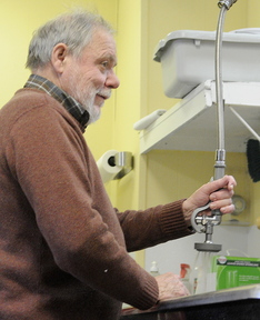Support: Michel Tessier, of Dresden, washes a dish Tuesday at the Bread of Life Soup Kitchen in Augusta. Tessier said he likes the openness Pope Francis has exhibited since becoming the leader of the Catholic Church. Tessier helps three days a week at the kitchen, which his wife, Patsy, manages.