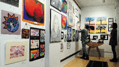 Teen talent: Monmouth Academy students Kayla Frost, left, and Sara Caruso participate in an art show with work by students from eight area high schools in March at The Harlow Gallery in Hallowell.