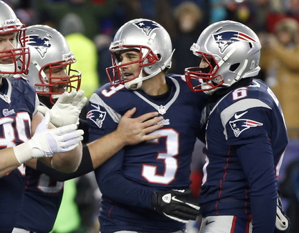 New England Patriots kicker Stephen Gostkowski, center, is congratulated after his game-winning fieldgoal against the Denver Broncos in overtime of an NFL football game early Monday, Nov. 25, 2013, in Foxborough, Mass. The Patriots won 34-3. (AP Photo/Steven Senne)