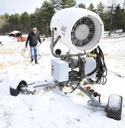 COOL: Dave Beers uses a propane heating torch to thaw frozen equipment on one of the two new snow guns at Eaton Mountain in Skowhegan on Wednesday.