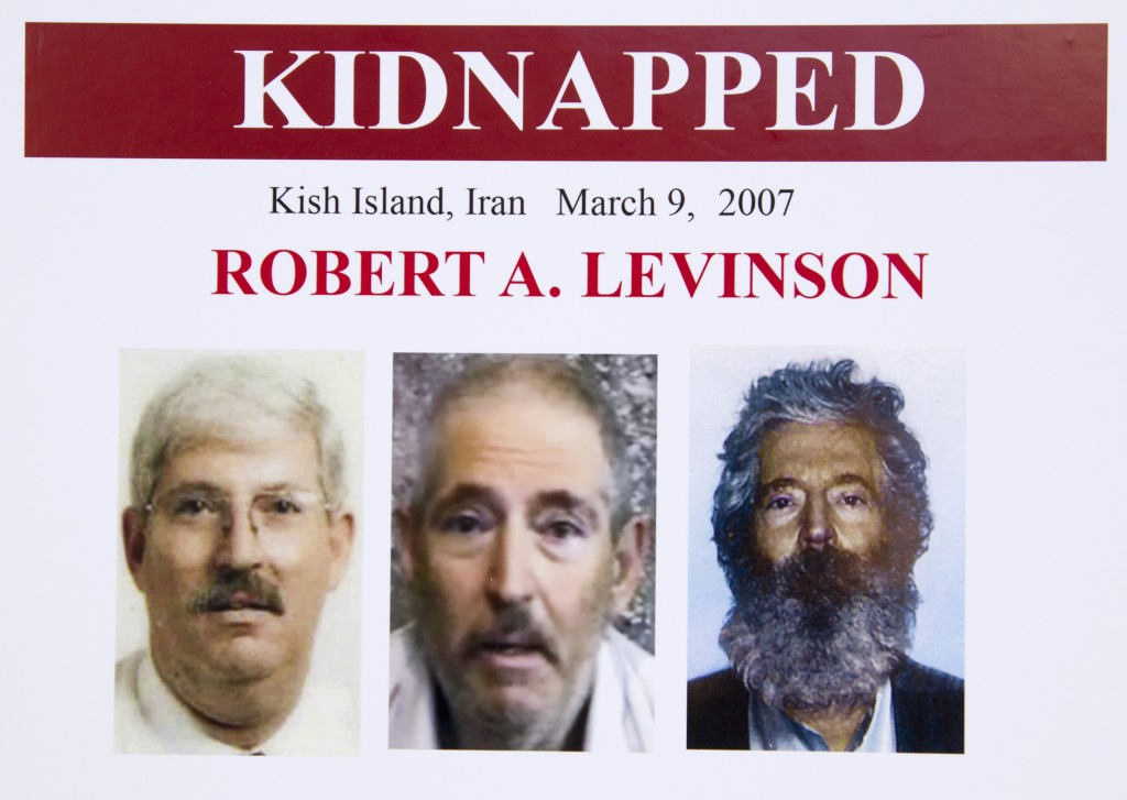 An FBI poster showing a composite image of retired FBI agent Robert Levinson, right, of how he would look like now after five years in captivity, and an image, center, taken from the video, released by his kidnappers, and a picture before he was kidnapped, left, displayed during a news conference in Washington, on March 6, 2012. The FBI announced a reward of up to $1,000,000 for information leading to the safe location, recovery and return of Levinson, who disappeared from Kish Island, Iran, on March 9, 2007.