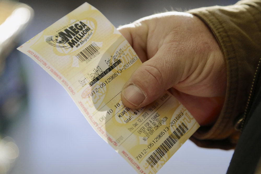 Pete Sturtevant holds Thursday, Dec. 12, 2013, a Mega Millions ticket he bought at the Speedee Mart store in Gretna, Neb., where someone bought a winning Powerball ticket the previous day. Lottery officials behind Mega Millions say the lesser known game alongside Powerball is grabbing some attention with a $400 million jackpot _ an estimated amount that comes less than two months after a major revamp to the game.