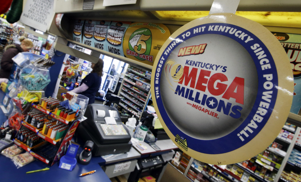 A woman buys lottery tickets at the One Stop store, Thursday, Dec. 12, 2013, in Newport, Ky. Friday's Mega Millions drawing has an estimated jackpot of $400 million.