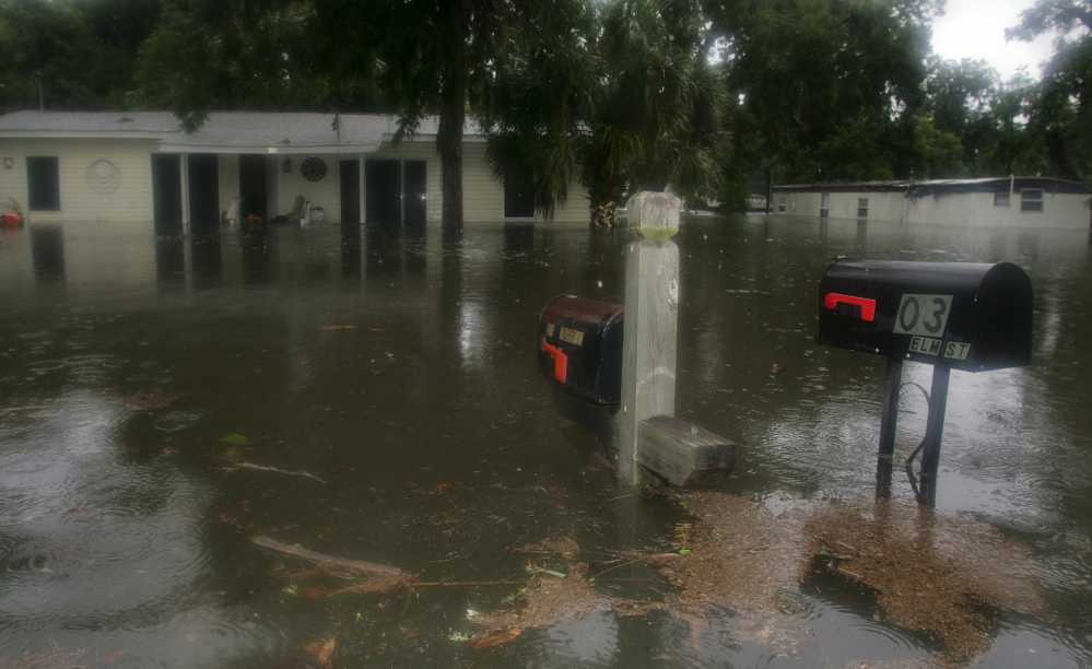 Homeowners in Live Oak, Fla., who endured flooding last year after a tropical storm are among millions in the U.S. facing higher premiums on required federal flood insurance.