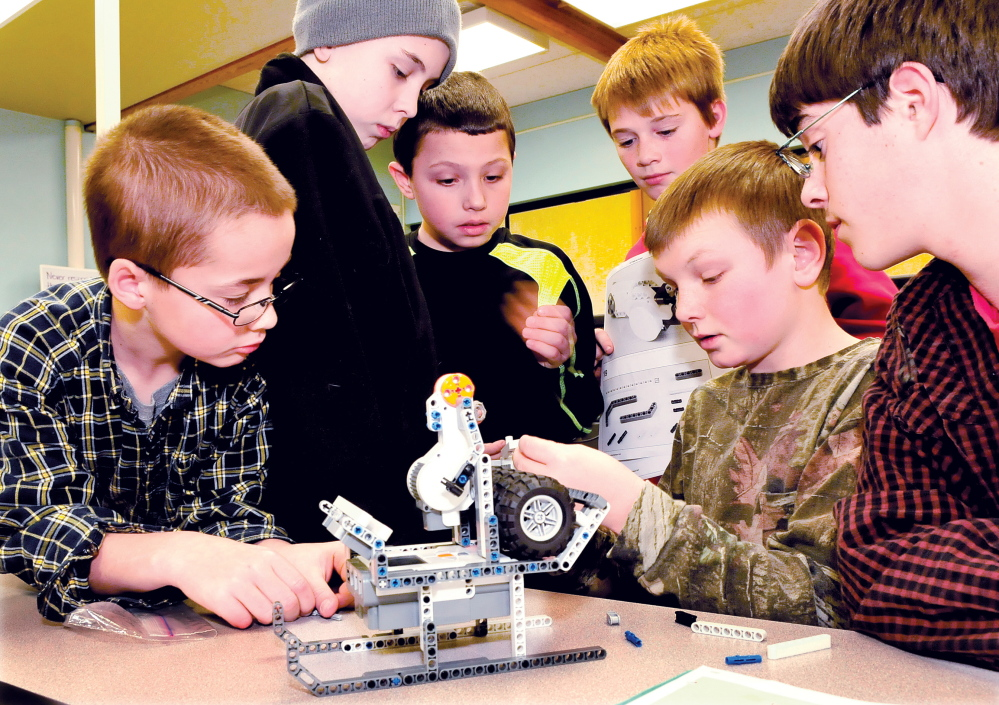 PIECE BY PIECE: Clinton Elementary School students assembled a Lego Santa Claus in a sleigh at the school this week. From left are Devin Harriet, Zachary Delile, Damien Peavey, Cody Dixon, Bryce Dostie and Ethan Cochrane.