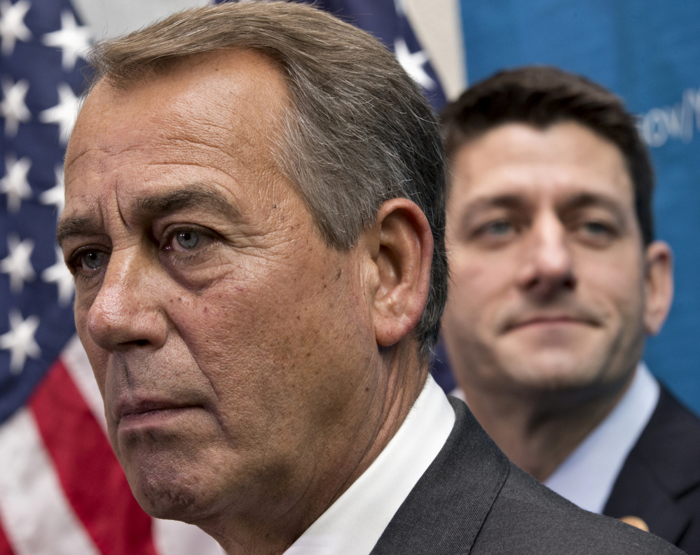 House Speaker John Boehner of Ohio, left, is flanked by House Budget Committee Chairman Rep. Paul Ryan, R-Wis., who with Senate Budget Committee Chair Rep. Patty Murray, D-Wash., worked out a budget deal. That deal leaves out extension of certain tax credits, which will now expire Dec. 31.