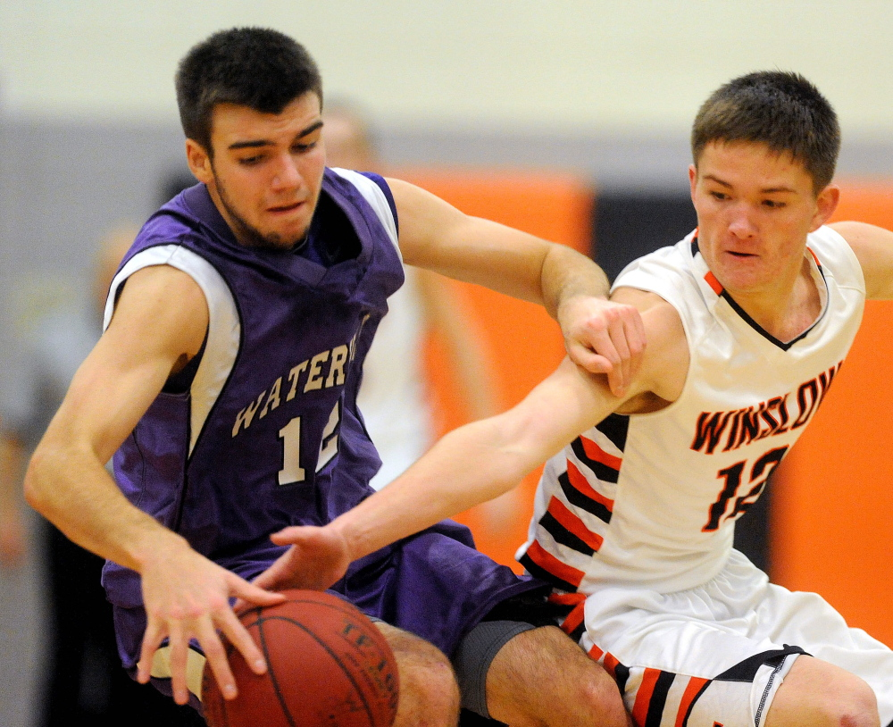 HIGH SCHOOL BASKETBALL: Winslow High School's Connor Wildes, 12, tries to steal the ball from Waterville Senior High School's Justin Jabar, 12, in the first quarter in Winslow on Saturday.