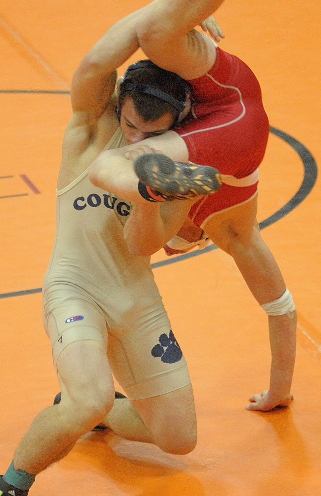 Mount Blue's Nick Hickey, left, and Cony's Victor Tapia-Smith compete in a 160-pound championship semi-finals match during the Tiger Invitational on Saturday December 14, 2013 in the John A. Bragoli Memorial Gym in Gardiner. Hickey eventually pinned his opponent to win in overtime.