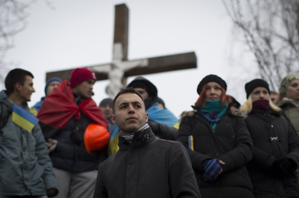 Ukrainians listen to a speaker during a pro-European Union rally at Independence Square in Kiev, Ukraine, on Sunday.
