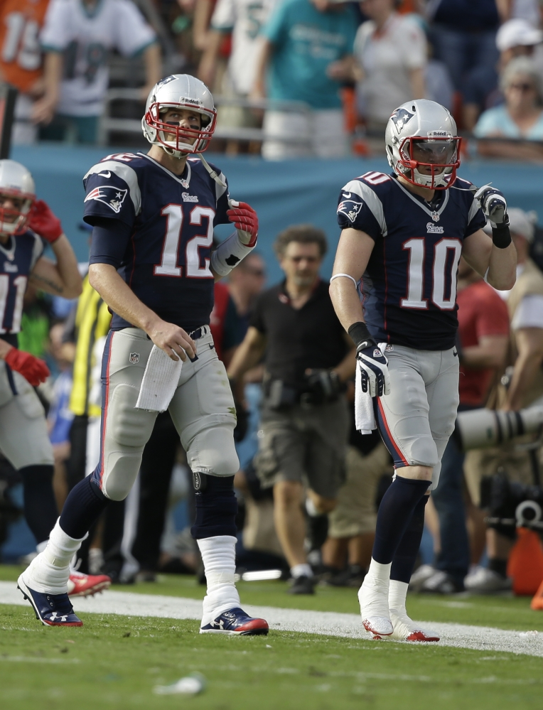 TOUGH ENDING: New England Patriots quarterback Tom Brady (12) and New England Patriots wide receiver Austin Collie (10) come off the field after a pass intended for Collie was intercepted by Miami Dolphins' Michael Thomas late in the fourth quarter of the Dolphins' 24-20 win Sunday in Miami Gardens, Fla.
