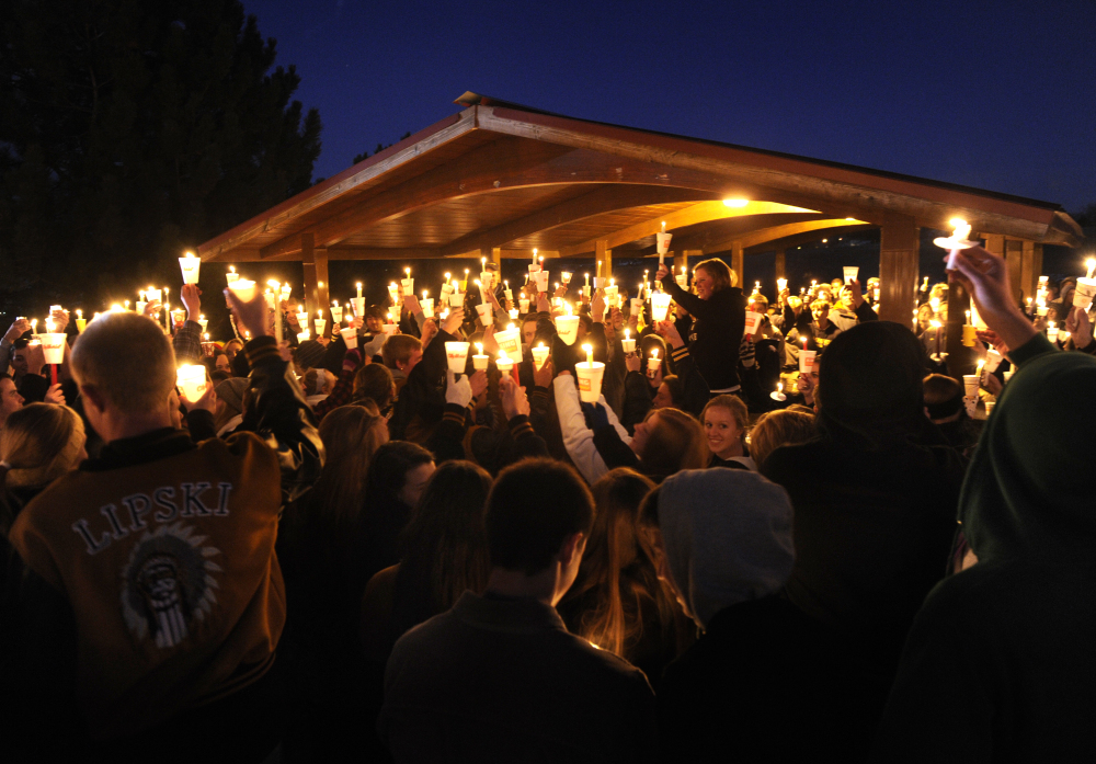 Hundreds of Arapahoe High School students gathered for a candlelight vigil Saturday night, Dec. 14, 2013, to share their prayers for Claire Davis who was shot inside the school Friday, Dec. 13, 2013. The vigil was held at Arapaho Park in Centennial, not far from the school.