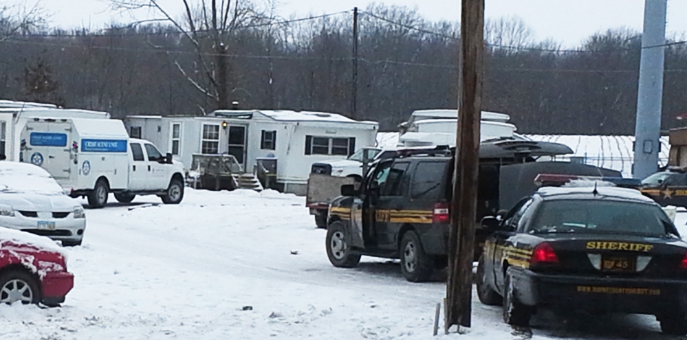 Wayne County sheriff's deputies secure the scene while investigators from the Ohio Bureau of Investigation search a mobile home in Wayne County's Green Township on Sunday, Dec. 15, 2013. Jerrod Metsker, 24, was arrested at his home on a murder charge about 12 hours after deputies found the body of Reann Murphy near her home at a mobile park in Smithville, about 30 miles southwest of Akron, Sheriff Travis Hutchinson said. Reann was last seen Saturday night playing outdoors at the park. Officers, firefighters and neighbors joined in the search for Reann, going door-to-door and combing area properties. Hutchinson wouldn't say how Reann was killed or offer a motive. He described Metsker as a family friend and neighbor.