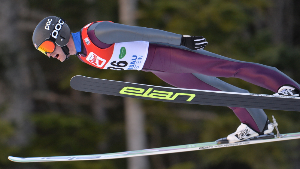 Bryn Fletcher from the United States soars through the air during the Nordic Combined World Cup competition in Ramsau, Austria, on Sunday. He is among those who train at the Utah facility.