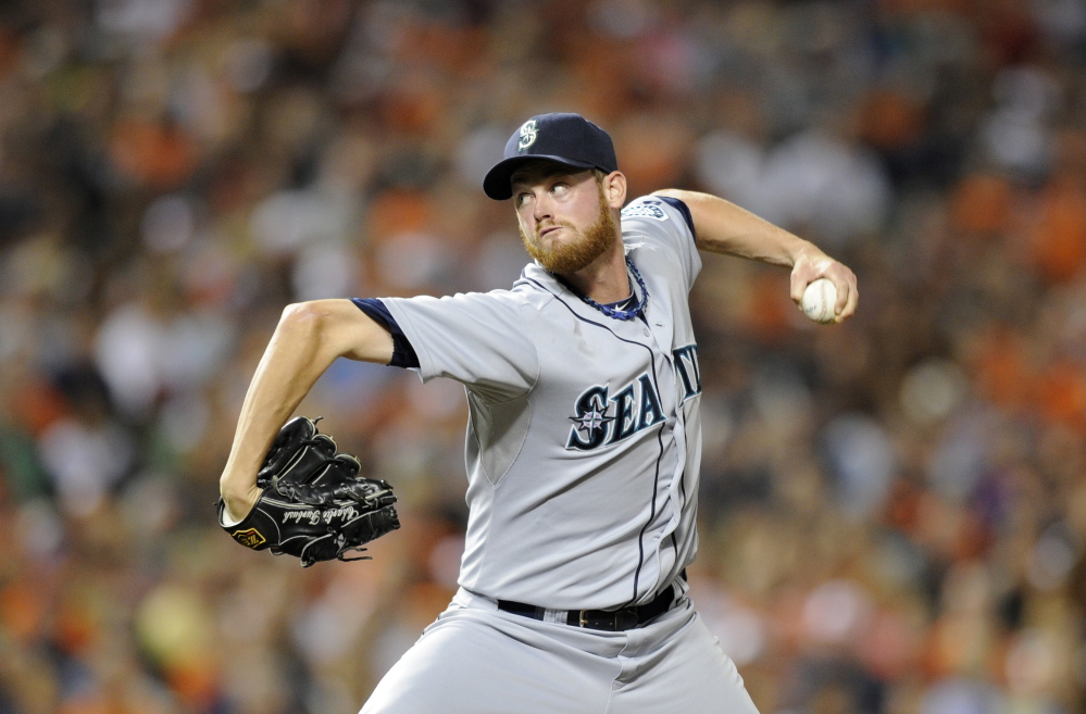 Seattle Mariners relief pitcher Charlie Furbush throws against the Baltimore Orioles during the eighth inning of a game in Baltimore in this Aug. 3, 2013, photo.