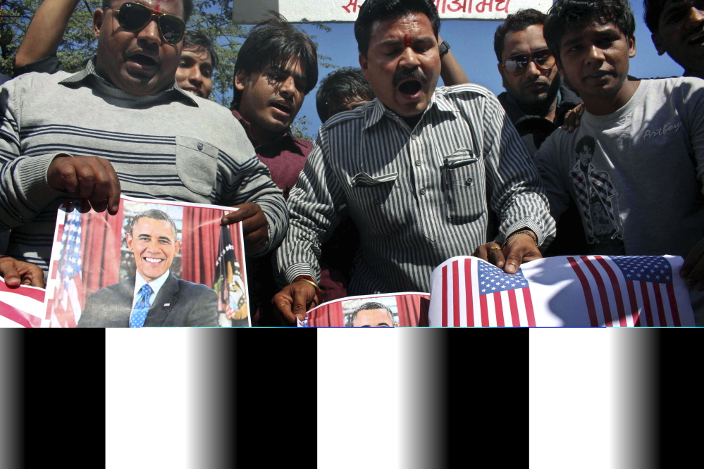 Activists of Sanskriti Bachao Manch, or save culture forum, burn posters of U.S. President Barack Obama and U.S. flags during a demonstration in Bhopal, India, Wednesday, to protest against the alleged mistreatment of New York-based diplomat Devyani Khobragade.