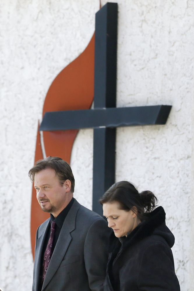 Accompanied by his wife Brigitte, right, the Rev. Frank Schaefer, of Lebanon, Pa., departs after a meeting with officials at the Eastern Pennsylvania Conference of the United Methodist Church on Thursday in Norristown, Pa. He planned to hold a news conference Thursday afternoon at a Methodist church in Philadelphia where an associate minister was defrocked in 2005 for being in a lesbian relationship.