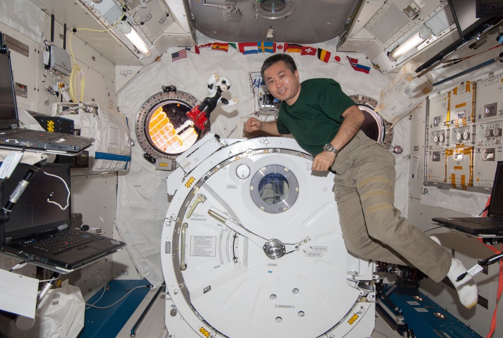 Kirobo and Japanese astronaut Koichi Wakata pose for a photo as they make small talk in Japanese at the International Space Station. The talks are part of an experiment testing the robot's autonomous conversation functions.
