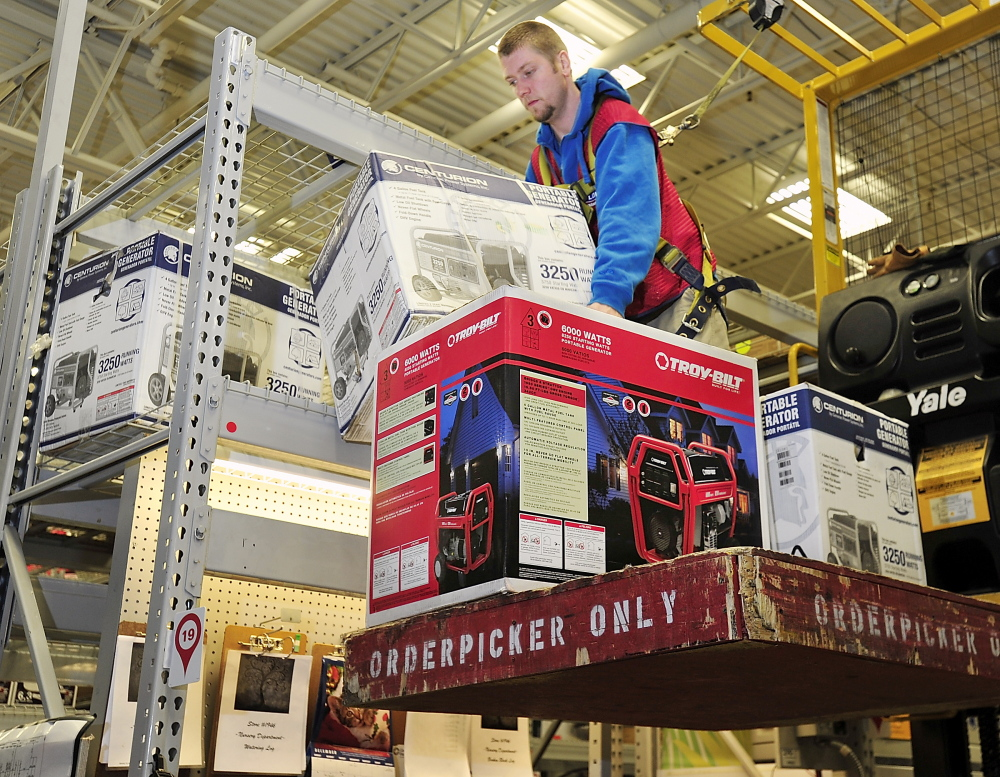 John Owen pulls down generators at Lowes in Portland on Friday in preparation for customers' needs this weekend if an ice storm causes electrical outages. Gordon Chibroski, Staff Photographer