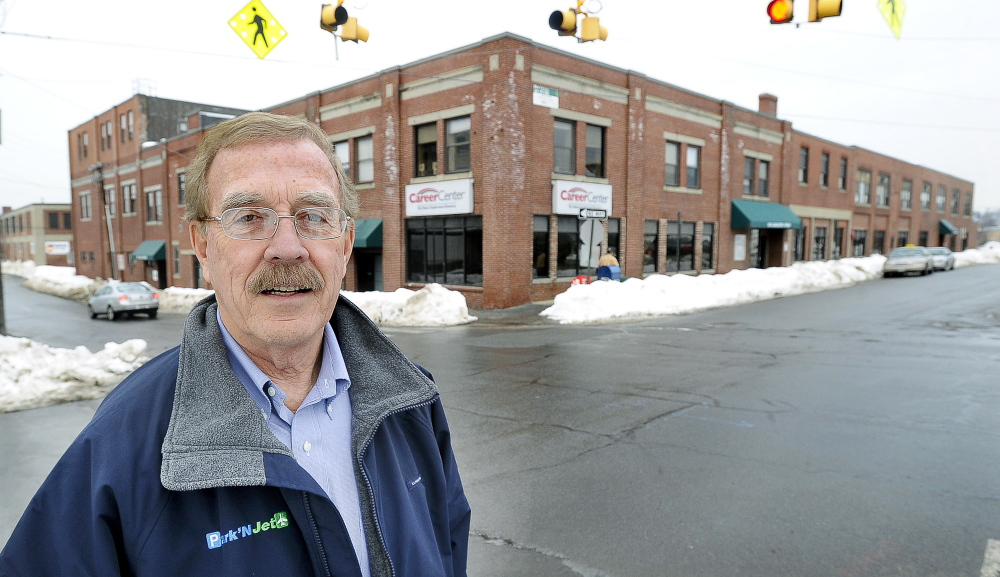 Developer Tom Toye stands in front of one of two Portland buildings on Lancaster Street that he owns and is offering to lease to the state Department of Health and Human Services.