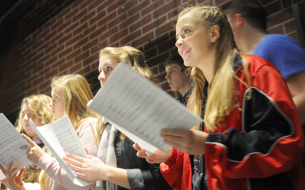 MAINE SINGS: Hall-Dale High School choral students rehearse songs by Stan Keach, of Rome, during a recent class. The two songs by Keach feature Maine icons Donn Fendler and Bean Boots by LL Bean.