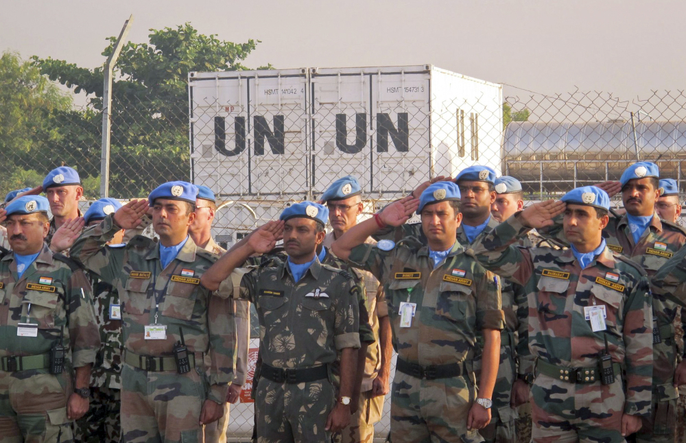 U.N. peacekeepers salute during a memorial service for their two colleagues who were killed Thursday, in the UNMISS compound in Juba, South Sudan Saturday. The U.N. peacekeeping mission strongly condemned the unprovoked attack on a U.N. base in Akobo in Jonglei state, near the Ethiopian border, on Thursday that killed two Indian peacekeepers and injured a third.