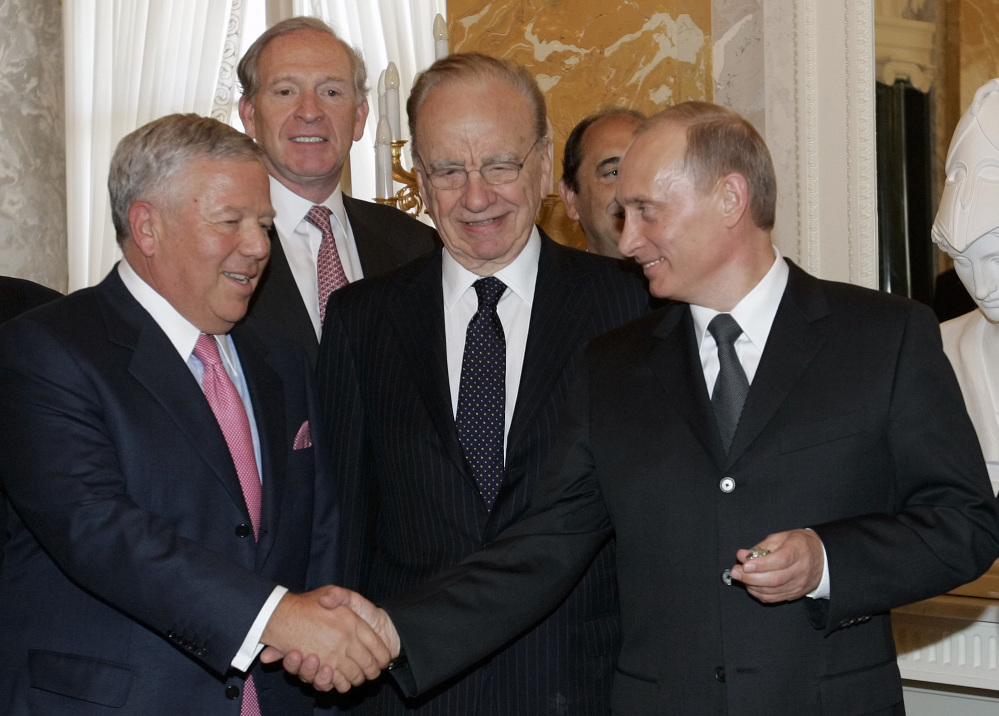 THAT'S MY RING: Russian President Vladimir Putin, right, shakes hands with New England Patriots owner Robert Kraft while holding Kraft's diamond-encrusted 2005 Super Bowl ring, as News Corp. Chairman Rupert Murdoch, center, looks on during a meeting of American business executives at the 18th century Konstantin Palace outside St. Petersburg, Russia in this June 25, 2005 photo. The mystery of Robert Kraft's wayward Super Bowl ring was one of many odd places sports wandered into in 2013.