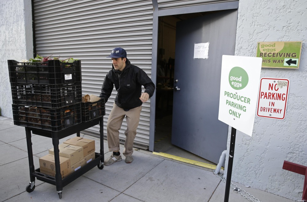 Travis Jackson, of Dirty Girl Produce, in Santa Cruz, Calif., delivers a shipment to the Good Eggs warehouse in San Francisco. Good Eggs has built a fast-growing business connecting foodies and farmers in Northern California.