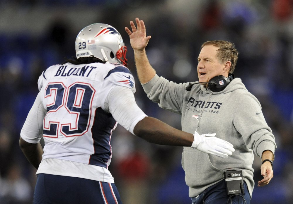 New England Patriots head coach Bill Belichick, right, celebrates with running back LeGarrette Blount after Blount scored a touchdown in the second half of Sunday's game against the Baltimore Ravens.