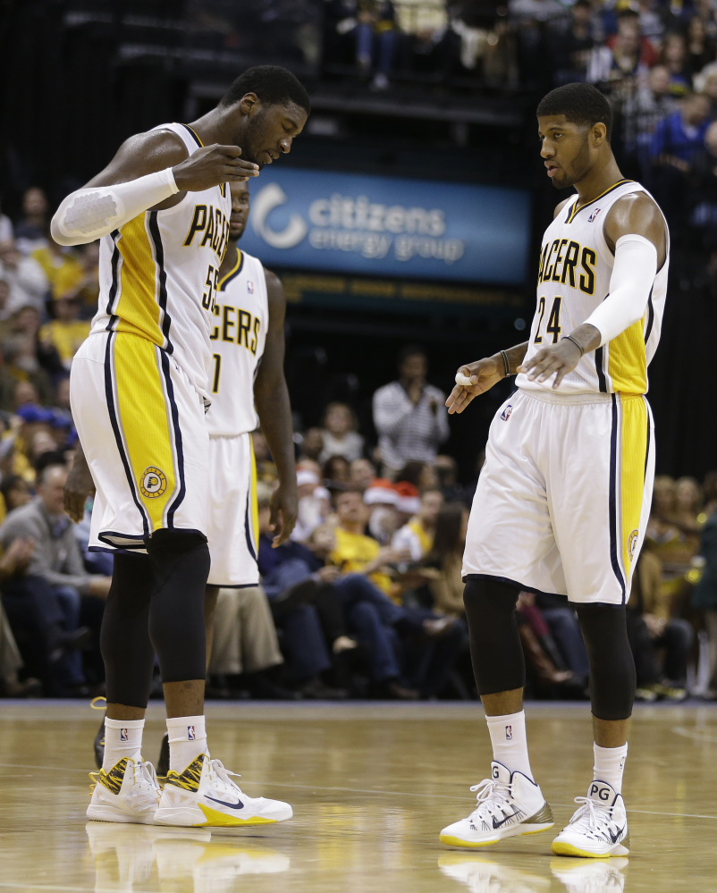 WINNING STUFF: Roy Hibbert, left, Paul George and the Indiana Pacers are one of just three teams in the NBA's Eastern Conference on pace to finish over .500 this season. Miami and Atlanta are also on pace for a winning record.