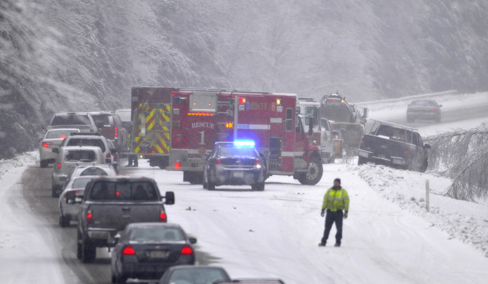 Staff photo by Michael G. Seamans STORMY TRAVEL: A multi-vehicle accident snarled traffic on the northbound lanes on Interstate-95 on the Sidney and Waterville on Thursday, Dec. 26, 2013. Snow has complicated matters in central Maine with residents still dealing with the ice storm that paralyzed much of central Maine this week.