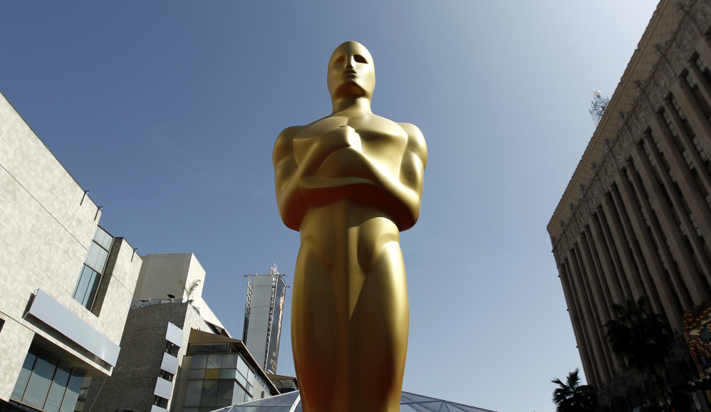 FILE - A Oscar statue is seen on the red carpet before the 84th Academy Awards in Los Angeles. Voting begins Friday, Dec. 27, 2013, for 2014ís Academy Awards nominees. Members of the Academy of Motion Picture Arts and Sciences are invited to cast secret ballots for their favorite film work from the past year until Jan. 8, 2014.