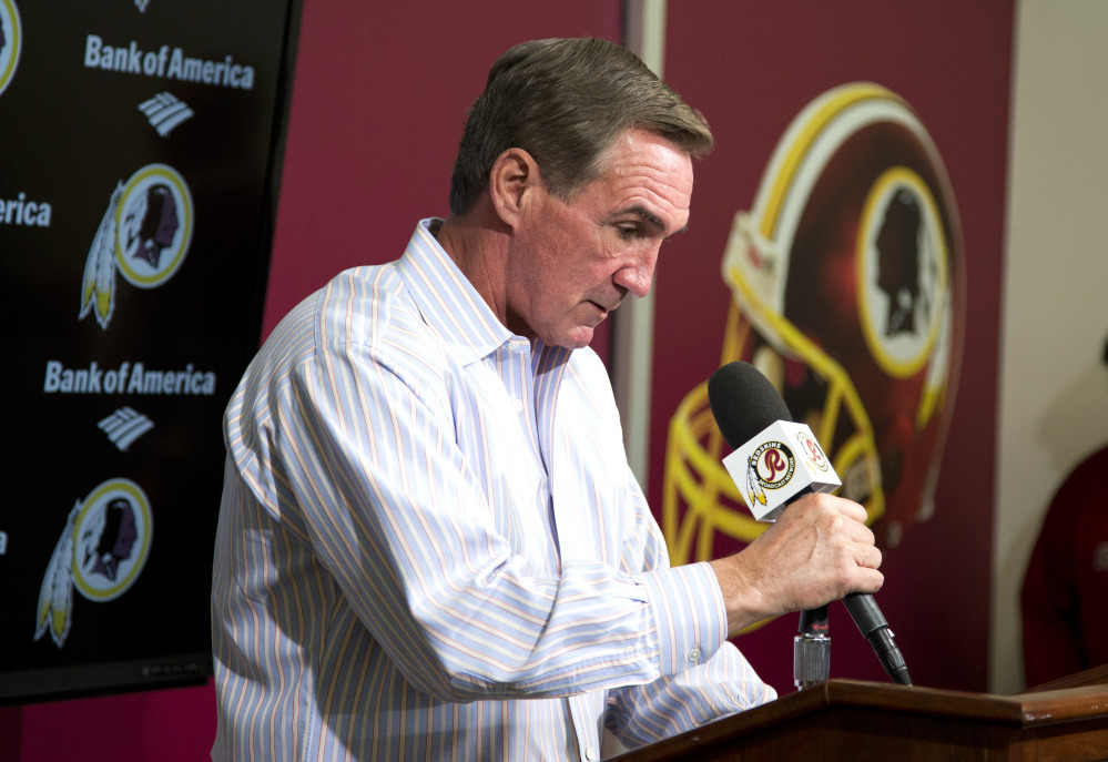 Former Washington Redskins coach Mike Shanahan delivers a statement after he was fired Monday at Redskins Park, in Ashburn, Va. Shanahan was let go after a morning meeting with owner Dan Snyder and general manager Bruce Allen.