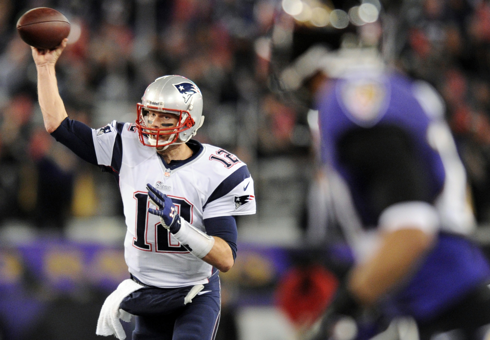 New England Patriots quarterback Tom Brady throws to a receiver in the second half of an NFL football game against the Baltimore Ravens, Sunday, Dec. 22, 2013, in Baltimore. (AP Photo/Nick Wass)