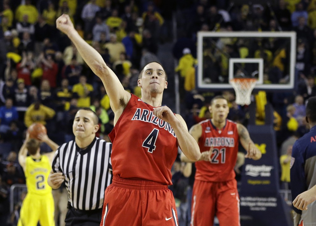 Arizona guard T.J. McConnell (4) celebrates after the Wildcats defeated Michigan 72-70 in Saturday's college basketball game in Ann Arbor, Mich.