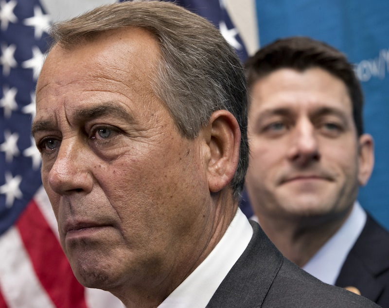 House Speaker John Boehner of Ohio, left, joined by House Budget Committee Chairman Rep. Paul Ryan, R-Wis., takes reporters' questions, on Capitol Hill in Washington, Wednesday, Dec. 11, 2013. Battle-fatigued and suddenly bipartisan, the House voted Thursday night to ease across-the-board federal spending cuts and prevent future government shutdowns.