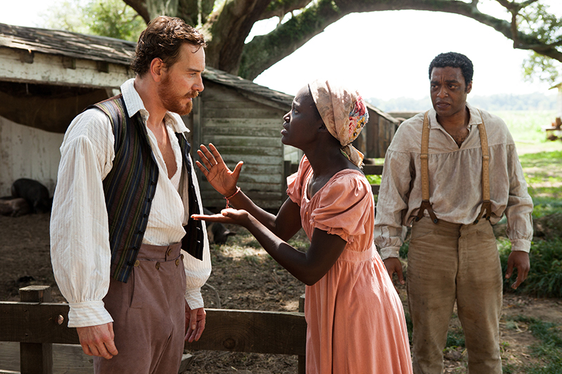 This image released by Fox Searchlight shows Michael Fassbender, left, Lupita Nyong'o and Chiwetel Ejiofor, right, in a scene from