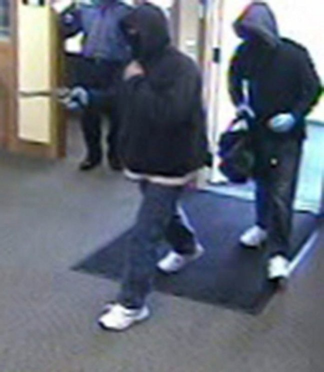 A bank surveillance camera shows the men who robbed a Kennebunk Savings Bank branch in Eliot in October.