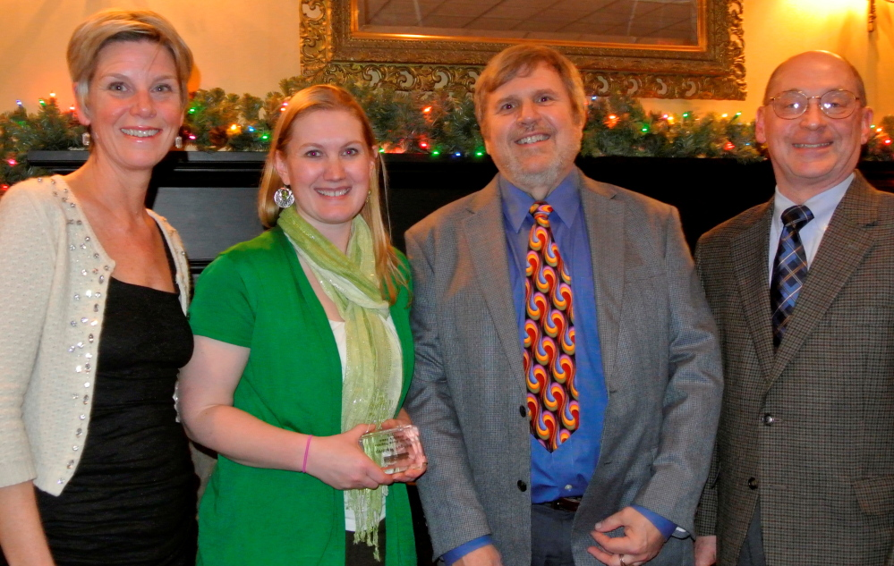 HONORED: Woodfords Family Services Board President Christine McKenzie, left, with Directors' Awardee Maegan Waldrop administrative support and teaching assistant, Central Maine Program and Oakland Preschool; Bob Barton, director of Central Maine Programs; and Executive Director Paul A. Nau, PhD, BCBA-D.