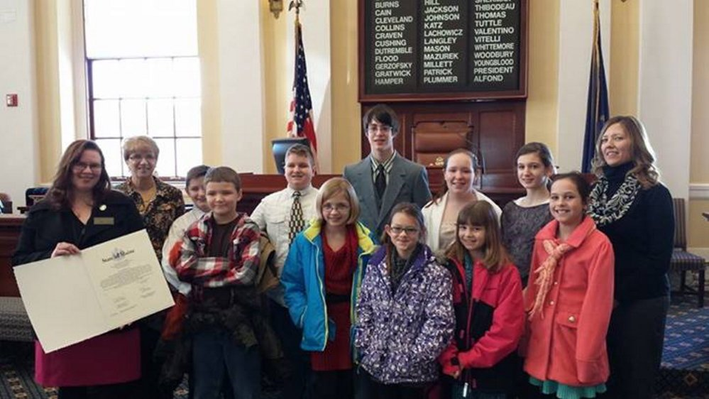 Clinton students recognized: Clinton Elementary School student council recently received an award from Sen. Lachowicz at the Senate Session. The students were recognized for the Hats for the Homeless community service project at their school. In front, from left, are Sen. Lachowicz, Jeremiah Christiansen, Jade Hanson, Haillie Hotham, Alivia Chalmers and Jorja Furchak. In back, from left, Librarian Marcia Buck, Storer Boyden, Ricky Hamlin, Eathan Cochrane, Brook Butler, Maya Chalmers and sixth;grade teacher Kelley Cloutier.