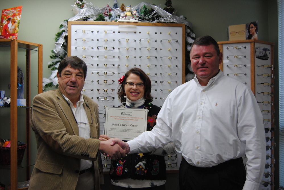 "Smart Eye Care of Augusta has joined in supporting the Viles Arboretum through its Business Partnership Program. From left are Mark DesMeules, executive director of the arboretum; board member Cathy Burnham; and Paul Wheeler, chief executive officer of Smart Eye Care, accepting a certificate in recognition of their support. ""We are very happy to support the good work of the Viles Arboretum. Many of our employees hike, ski, snow shoe and generally enjoy the many trails, exhibits, and programs the Arboretum holds each year,"" Wheeler said in a news release. For more information, call 626-7989 or visit www.vilesarboretum.org."