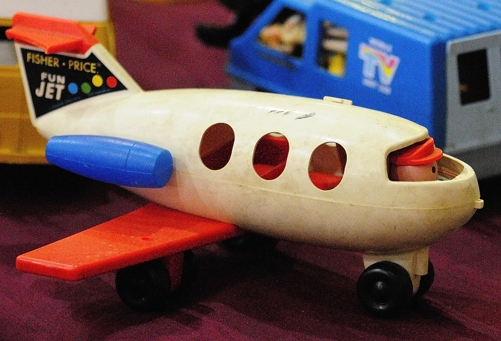CHILD'S PLAY: This Fischer-Price Fun Jet and other toys were among the items on display Wednesday during the New Year's Antiques Show at the Augusta State Armory.