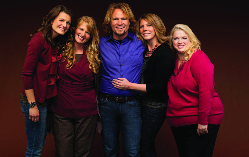 "Kody Brown,: of the TLC reality show ""Sister Wives,"" along with his four ""wives,"" from left, Robyn, Christine, Meri and Janelle, filed suit in 2011 to challenge parts of the law that they claimed violated their privacy rights. A federal judge last month struck down key parts of Utah's polygamy ban as unconstitutional."