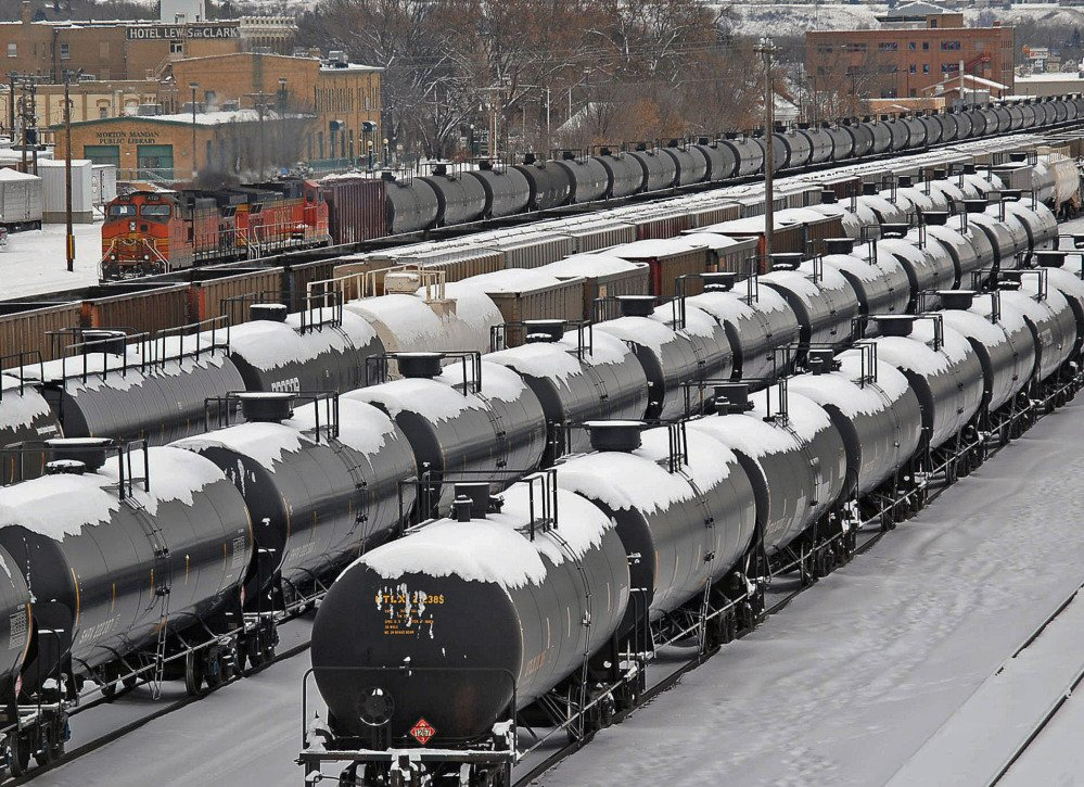 Rail cars are backed up in the yard Tuesday following a train derailment and a massive explosion in North Dakota the day before.