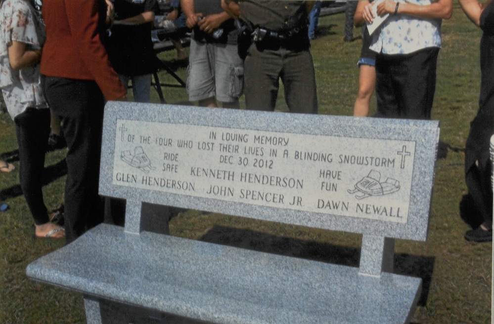 MEMORIAL: Relatives of the snowmobilers killed in Rangeley Lake donated a granite bench in their memory as well as to those who worked tirelessly to find them. The bench was placed in the Rangeley Lakes Chamber of Commerce park, near the lake, and dedicated Sept. 1.
