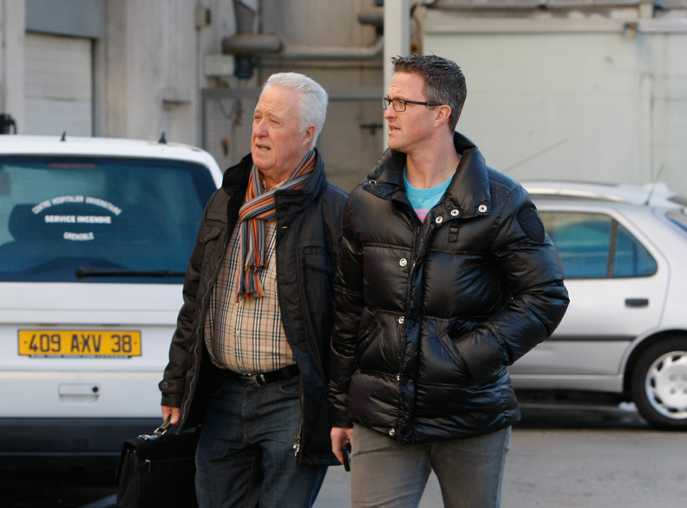 Michael Schumacher's father Rolf, left, and brother Ralf arrive at Grenoble Hospital, French Alps on Sunday, where former seven-time Formula One champion Michael Schumacher is being treated after sustaining a head injury during a ski accident. Schumacher has been in a medically induced coma since Dec. 29 when he struck his head on a rock while on a family vacation.