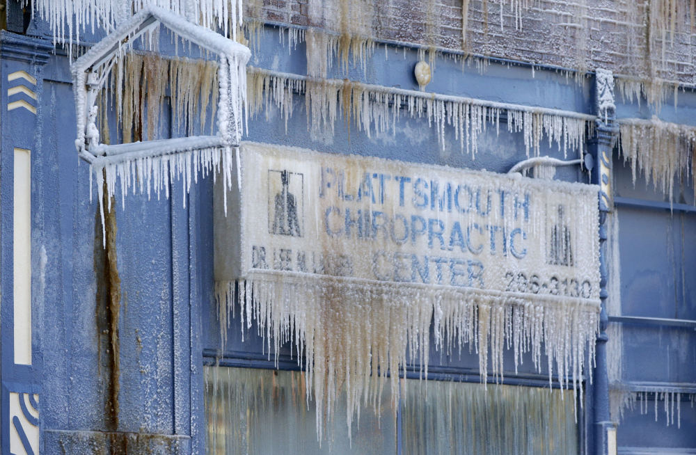 The Plattsmouth Chiropractic Center is decorated with icicles, after an adjacent building caught on fire in Plattsmouth, Neb., on Friday, and firefighters sprayed it with water.