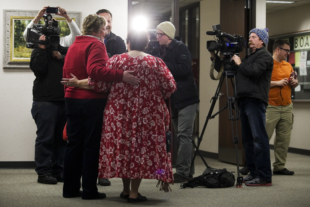 Cheryl Haws, left, and her partner Shelly Eyre hold each other while being interviewed by the media after their marriage license issued at the Utah County Clerk's office in Provo, Utah, in December. The U.S. Supreme Court put a hold on gay marriage in Utah.