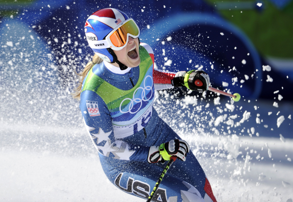 In this Feb. 17, 2010, file photo, Lindsey Vonn of the United States, reacts in the finish area after completing the Women's downhill at the Vancouver 2010 Olympics in Whistler, British Columbia. Vonn is going to skip the Sochi Olympics because of a right knee injury.
