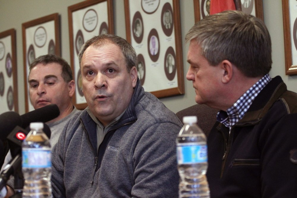 Canadian National Railway CEO Claude Mongeau, center, and New Brunswick Premier David Alward answer questions about the train derailment at a news conference in Plaster Rock on Wednesday. Mongeau sa that of the 17 cars that derailed in, five contain crude oil and four contain propane.