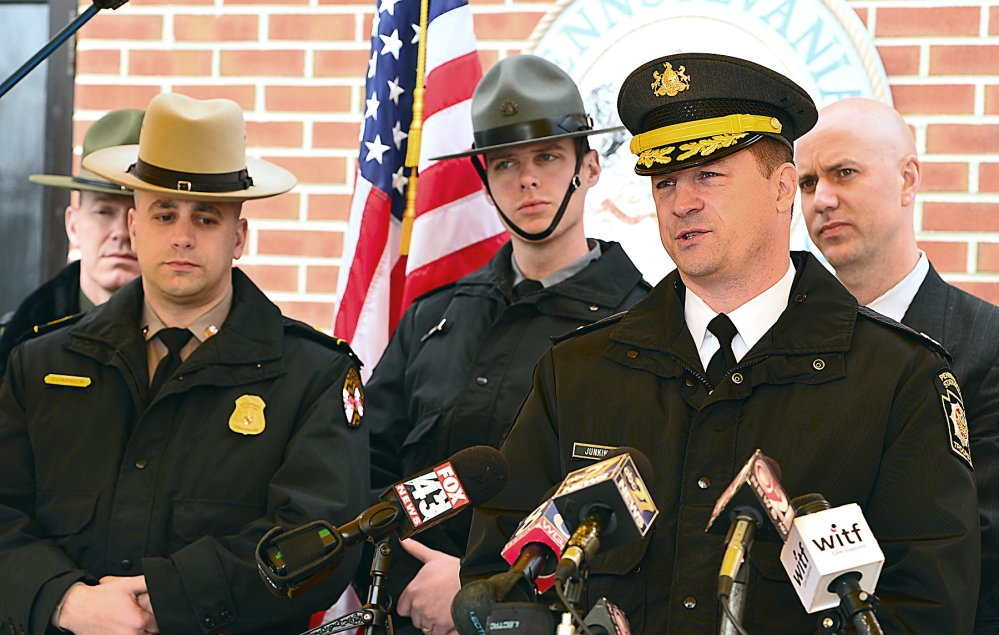 Pennsylvania State Police Capt. Steven Junkin, right, addresses the media Friday at the Chambersburg barracks in Pennsylvania. Junkin gave few new details of the investigation of the recent Interstate 81 killing of a Mainer.